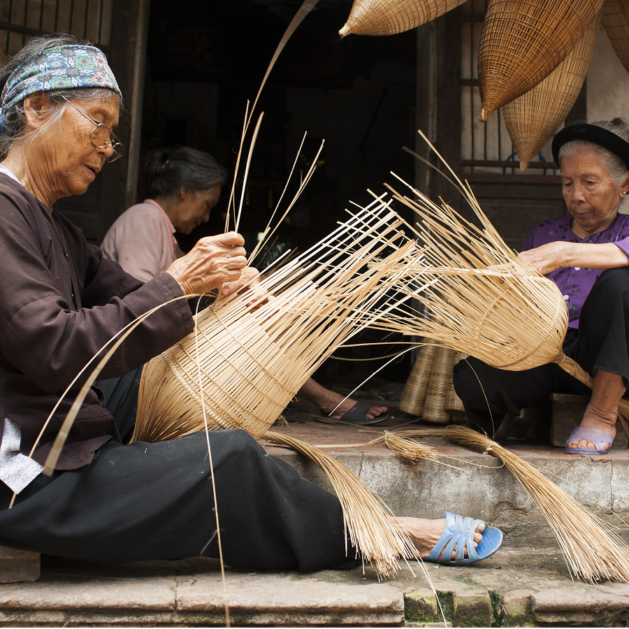 Women with traditional handicraft in Vietnam